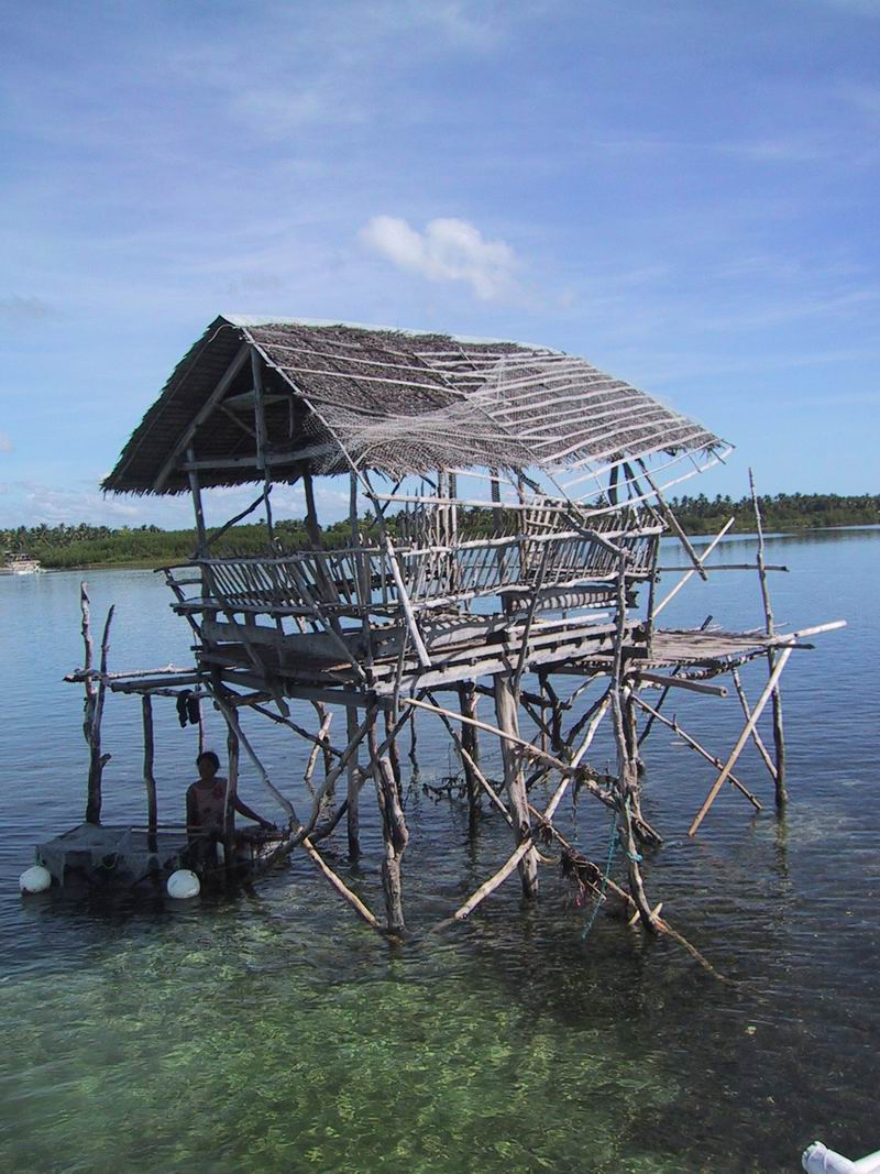guard house on reef flat used by community to watch over a local protected area